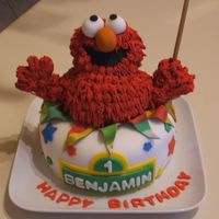 Elmo Cake White cake covered in fondant, Elmo is rice krispy treats covered in royal icing. Enjoy!