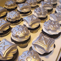 Steampunk Gear Cupcakes  Dutch Chocolate cupcakes with vanilla buttercream, topped with molded white chocolate. White chocolate was dusted with silver then hit with...