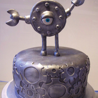 Steampunk Cake With Clank  This cake is a dutch chocolate cake, filled with raspberry and covered in chocolate fondant. The figure on top, Clank, is from a comic...