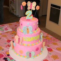 "Butterfly Cake 10"", 8"" and 6"" cakes covered in buttercream with fondant butterflies and flowers!"