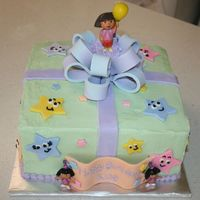 Dora Birthday Cake Dora cake for a 3 year old. Buttercream frosting with fondant stars, bow and banner. Dora candle attached to bow with buttercream frosting...