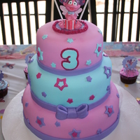 Abby Cadabby Cake All 3 tiers covered with fondant with fondant decorations and bow. Abby Cadabby candle topper