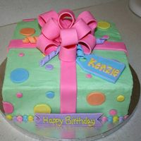 Birthday Present Cake! 2 layer filled cake with buttercream frosting and fondant decorations. Got idea for colors off a cake on this site!