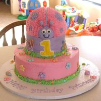 "Ladybug First Birthday Cake All white cake, 10"" bottom, 6"" middle and the ladybug was carved out of 2 6"" round cakes and placed on top. The butterflies..."
