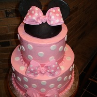 Minnie Mouse Cake Two tiers of vanilla bean cake with layers of vanilla bavarian cream and vanilla italian meringue buttercream
