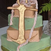 40Th Bd Golden Anchor Deep Dark Chocolate Cake with Buttercream Icing, Anchor and Rope made of MMF. Antique Gold Luster dust. Customer wanted the green to look...