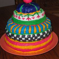 "Picadilly Made to replicate ""McKenzie Childs Picadilly Cookie Jar"" Chocolate cake with buttercream icing."