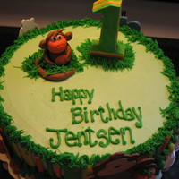 Jungle Monkey!  1st birthday cake for a jungle themed party. Cake is half chocolate and half vanilla, icing is buttercream, fondant accents (striped, #1on...