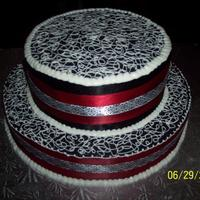Black & White Round Cake Two Tiered, First attempt at using black in a cake. This is purely buttercream & satin ribbons.