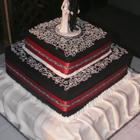 Black & White Square Wedding Cake   3 tier Buttercream filling, fondant covered cake.