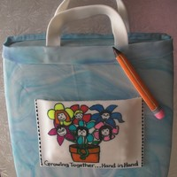 Tote Bag W/ Kid Logo  This is a 1-layer cake covered in marbled fondant, w/ fondant accessories (pencil, tote bag pocket). Pocket is personalized w/ colored logo...