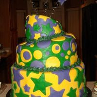 Mardi Gras Birthday Cake I am so excited about this cake! This is my second tiered cake, second try with fondant and first try with topsy turvy and making a cake...
