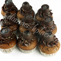 Chocolate Cupcakes   chocolate cupcakes with ganache, decorated with pralines - marzipan nougat cream filing :D