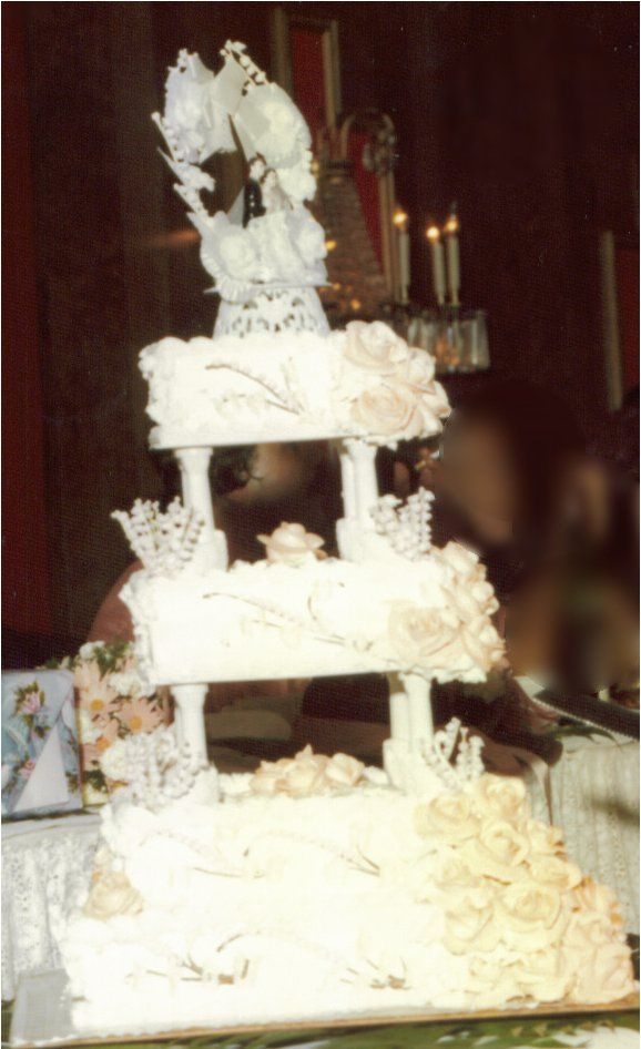 Vintage 1977 Wedding Cake Our 1977 wedding cake, made by unknown baker at wedding venue. It was white with salmon/peachy roses. I have no idea what the filling was,...