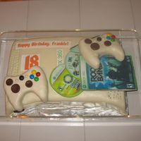 X-Box 360 Birthday Cake Pistachio cake, fondant covered. Rice Krispies Treats controllers, edible image CD and game packages.