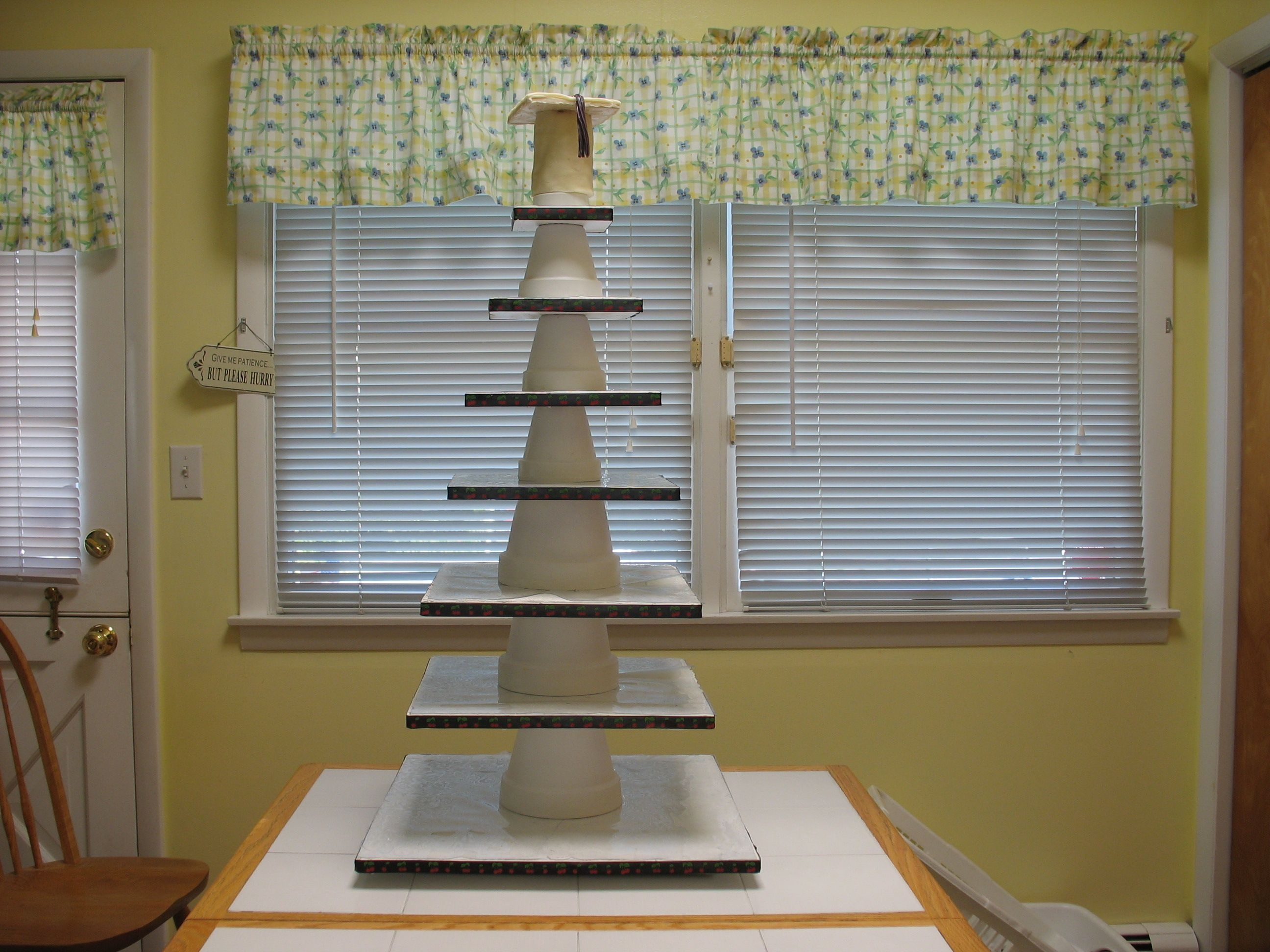 7-Tier Cupcake Tower I made this 7-tier cupcake tower from plywood and flower pots. The plywood is covered with doilies then vinyl tablecloth material. The...
