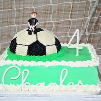 Soccer Boy And Ball   Whipped cream frosting and chocolate cake chocolate buttercream. My first figure made with fondant.