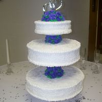 3 Tired Cake With Purple Roses