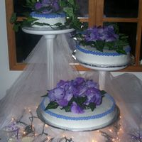 3 Stands Wedding Cake the flowers are silk