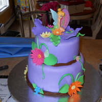 Tinker Bell I made this cake for my daughter's 9th birthday. It is vanilla cake with vanilla buttercream covered in fondant. Flowers are gumpaste...