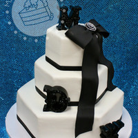 Buttercream With Black Ribbon & Monograms Cake iced in buttercream with real black ribbon around the base of each tier. The bow was gum paste with the bride's brooch in the...