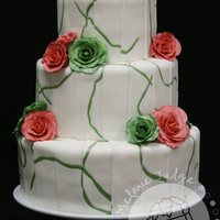 Salmon & Green Fondant Wedding Cake Cake decorated with strips of fondant applied individually. Roses made of gum paste.