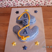 Congrats For Usna Admission.  This is a cake made for my son's friend who is leaving for the United States Naval Academy. The anchor is carved with a fondant rope...