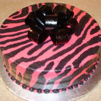 Zebra Print Cake This was for a friend of mine's birthday. She wanted zebra print done in pink and black. I really like the way it turned out. Bow is...