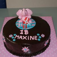 Chocolate Cake   Chocolate cake, covered in ganache with pink fondant elephant.