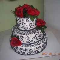 """glammed Up"" Dummy Cake... This is the same cake that I uploaded the other day! I decided to add a couple of Silk flowers to add a punch of color!!"