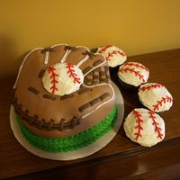 Baseball Glove Fondant baseball glove (2 tiered, 8 inch cake) and matching baseball cupcakes.