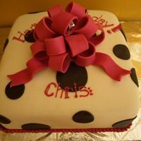 Chris_Cake_Angled.jpg White cake, Butter cream, Fondant frosting, dots, and bow