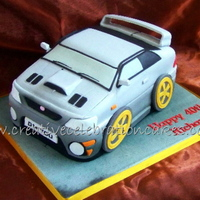 Subaru  I got board with doing basic car cake, yaaaaaawn.........So when my friend asked me to do a Subaru for her husband I decided to experiment...
