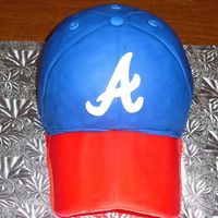 "Atlanta Braves Hat Cake use half sports ball and 6"" pan. white cake w/ choco bc. gumpast brim and all covered in fondant. ""a"" was cut from fondant..."