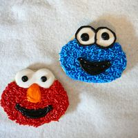 "Elmo And Cookie Monster Cookies NFSC with RI eyes. Both frosted with bc and then put sprinkles to resemble ""fur""For my sons first birthday party. Just test..."