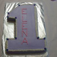 "1St Birthday Cake 11x15 sheet cake cut in the shape of a ""1"" . My friend wanted simple...white cake with buttercream and purple royal icing drop..."