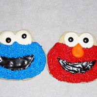 Elmo And Cookie Monster Cookie Elmo amd cookie for my sons 1st birthday party. the other ones in my photo were the test cookies. i think these came out much better. nfsc...