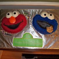 Elmo And Cookie Monster Cake For my sons 1st birthday. i got this idea from marowe4 on here. I used the grass tip for fur and used buttercream frosting. It was hard to...
