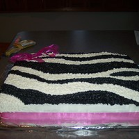 Katie's Zebra Birthday White 1/2 sheet cake with real pink ribbon; zebra pattern freehanded onto cake. TFL!