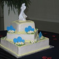 3 Tier Square With Butter Cream. Color Flow Hearts And Gumpaste Daisys   This was my first wedding cake