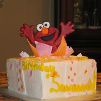 Color Flow Elmo Popping Out Of Of A Present.  I love Elmo here, but I was not too happy with the rest. I wanted to paint my fondant, but, I did not use the right products. My fondant...