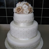 "Ivory Wedding Cake Bottom tier 12"" chocolate mud cakemiddle tier 9"" white choc and raspberrytop tier 6"" fruit cake"