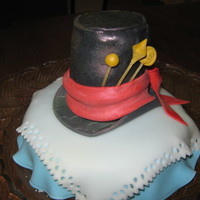 Mad Hatters Hat table cloth represents Alice's dress, frangelico chocolate cake, hat is caramel mud cake.
