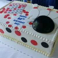 Bowling And Bingo A carrot cake with cream cheese frosting filling, iced with SMBC. Fondant bingo card, bowling pins, and message plaque. Bowling ball was a...