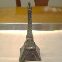 3-D Chocolate Eiffel Tower Dark tempered chocolate with silver dust, dry brushed. Bride sent me a picture of another tower to duplicate for her wedding cake topper -...