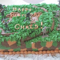 Camo Army Cake For 10 Yr Old Boy 7X13 cake, top layer vanilla, bottom layer chocolate, all buttercream. This was my first attempt at doing camo on a cake and it turned out...