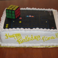80's Theme Birthday Cake 80's theme birthday cake for a 30th birthday party. Rubik's cube is made of rice crispy treats, covered in black fondant with...