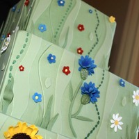 "Garden Cake Offset squares: 6"", 9"", and 12"" in sage green fondant with a funky garden motif. Cornflowers, dahlias, sunflowers, daisies,..."