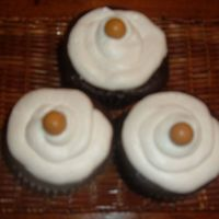 Peanut Butter Cuppies  Darn Good Chocolate Cake with a peanut butter flavored bettercream filing and topping.. Topped with a peant butter whopper. Thanks Mel for...