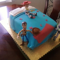 Toy Story Bed Cake I love this cake, a friend found this picture online and asked me to do it for her child's b-day. Fondant covered 1/4 sheet cake and...